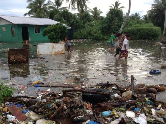 High tides on October 9, 2014 cause flooding in Majuro - Credit: Kathy Kijiner