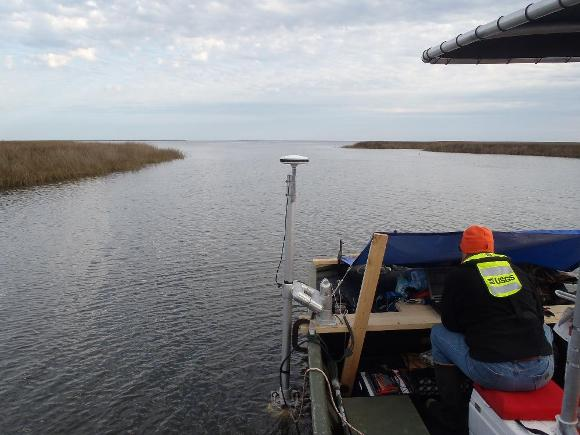 Photograph of moving-boat ADCP discharge measurements being made in Bayou Heron.